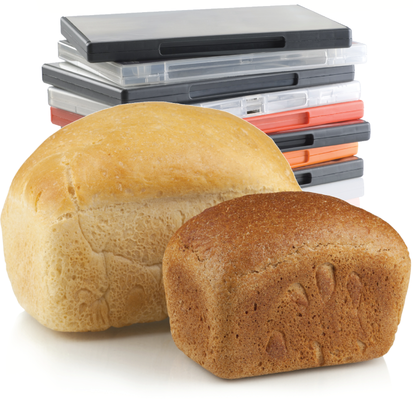 Two loaves of bread in front of a stack of disc cases.